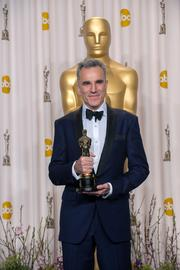 "Daniel Day-Lewis won his third Oscar--a record in the best actor category--for portraying ""Lincoln."""