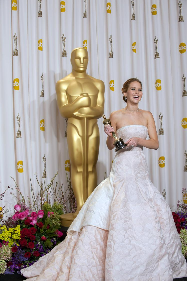 Twenty-two-year-old Jennifer Lawrence recovered gratefully after tripping on her way to the stage to claim her Oscar for best actress.