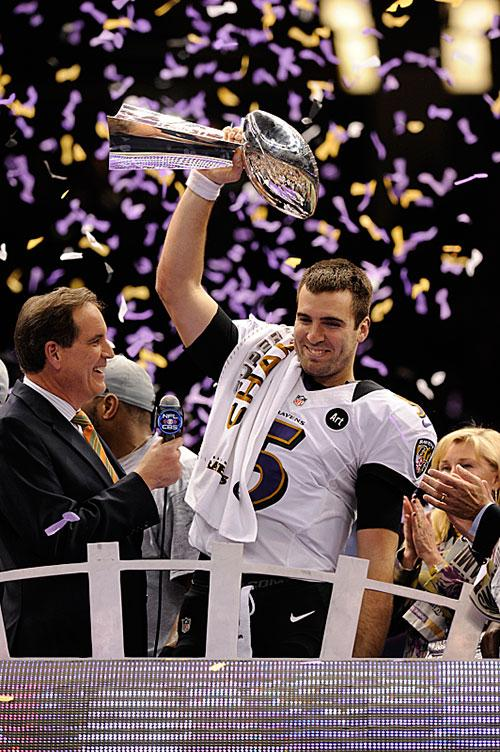 Joe Flacco holds up the Lombardi Trophy following the Ravens' Super Bowl victory.