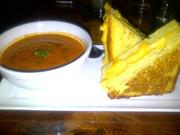 The menu features twists on classic American favorites. This is best seen in the grilled cheese sandwich, served on Brioche, with tomato soup.