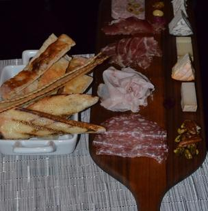 The Penthouse's house-made charcuterie plate and artisanal cheeses