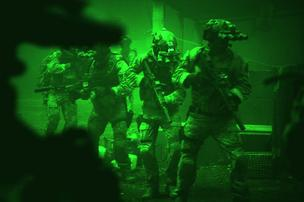 "In this scene from ""Zero Dark Thirty,"" Navy SEALs prepare to breach a locked door in Osama Bin Laden's compound."