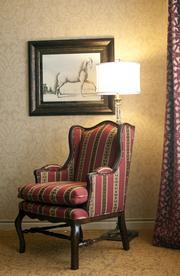 More horses, with a chair that complements the theme.