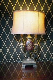 This lamp illuminates the bold wall coverings in the suite.