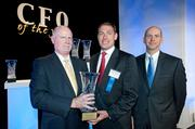 Business First publisher Tom Monahan, left, presents a CFO of the Year  award to Garett Jackson, of the National Patient Account Services Inc. Pictured at  right is Greg Hintz, of event sponsor Crowe Horwath.