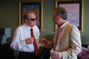 Louisville Mayor Greg Fischer talked with Henry Conn during Oaks Day races.