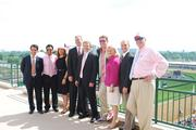 A group of guests of the University of Louisville Foundation posed for a picture on the balcony outside the foundation's Jockey Clubs Suite.