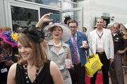 Actress Debra Messing took a photo as she arrived at Churchill Downs on Derby Day.