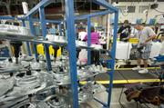 An array of parts for the new top loading washer at GE were staged for easy access to the production line.