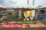 Workers prepared for the Louisville Blues-N-Barbecue Festival at the Water Tower in July.