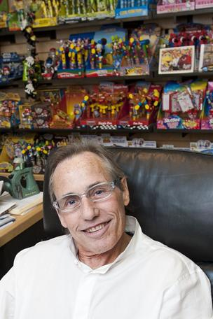 Rob Auerbach, president of CandyRific, is shown in his office filled with examples of products the company has licensed.      Click here to read an article on the company's deal with The Walt Disney Co.