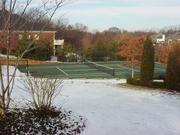 A tennis court also is on the 3-acre property.