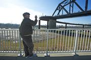 Rick Bell, who has written a book on the history of the Louisville riverfront, took pictures during the Big Four Bridge grand opening.