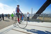 Carson Torpey rode his antique high-wheeler bicycle across the Big Four Bridge.
