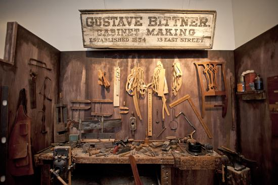 A replica of Gustave Bittner's original workbench is part of the display at the Frazier History Museum.