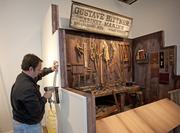 Monty Fields assembled the display for one of the Bittners displays at the Frazier Museum.