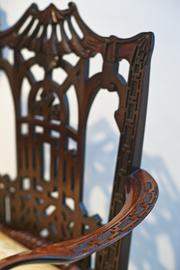 Detail of the arm and back of a Chinese Chippendale style armchair from a private collection is shown here.