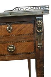 This photo shows detail from a Mahogany and Tulipwood Directoire Bureau Plat dated 1795.