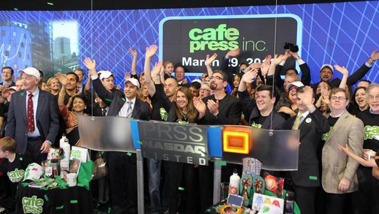 CafePress CEO Bob Marino, wearing glasses, claps as the company's employees celebrate its IPO by opening the NASDAQ Stock Market.