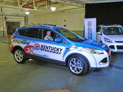 NASCAR driver Matt Kenseth drives out a 2013 Ford Escape model for the announcement.