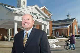 Randy Bufford, president and CEO of Trilogy Health Services, is shown at the Franciscan Health Care Center, one of many properties the company owns.