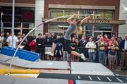 Former University of Kentucky vaulter Samantha Stenzel took off during Vault in the Ville at Fourth Street Friday.