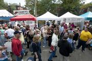 Local businesses such as Sweet Spot Catering and Heine Brothers' Coffee set up shot around the St. James Court Art Show.