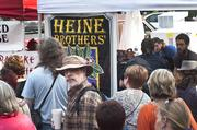 Food and drink vendors such as Heine Brothers' Coffee were popular Friday at the St. James Court Art Show.