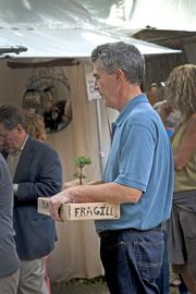 A fragile treasure was purchased early on Friday by a patron at the St. James Court Art Show.