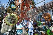 Dwight Smith and Katie Miles, owners of A Moment in Time, a Louisville business, sell all kinds of colorful windcatchers and suncatchers.