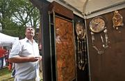 A shopper looked at the clocks created by artist Vince Pompei of St. Petersburg, Fla., who was showing at the St. James Court Art Show for the first time.