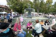 Several patrons ate lunch by the St. James fountain.