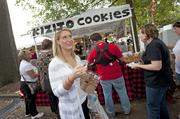 With a beer in one hand and a Kizito cookie in the other, Allie Rawley, of Louisville, was set to enjoy the St. James Court Art Show.