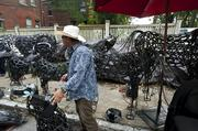 Sculptor Keith Bradley stood in front his metal animal sculptures.