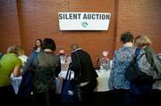 A silent auction was part of the Taste of Kentucky Derby Festival event, which raised money for Dare to Care Food Bank.