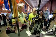 Kenneth Delcour, left, and Larry Mahoney looked at guitars donated for the silent auction by bands such as Lady Antebellum and Chicago.