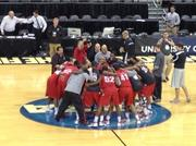 The Western Kentucky team gathered at midcourt.