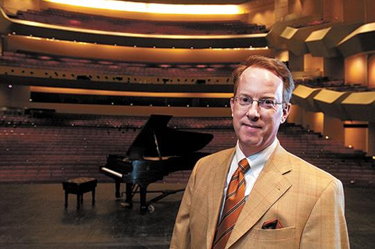 Robert Birman, CEO of the Louisville Orchestra, is shown on stage at the Center for the Arts.