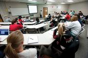 A graduate-level accounting class in auditing is taught by Dr Liz Payne at U of L's College of Business. A shortage of accounting professors means more expenses are in store for local universities.