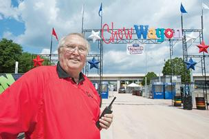 Charlie Cox of Concessions and Catering by Cox is shown in front of an entrance to the Chow Wagon.