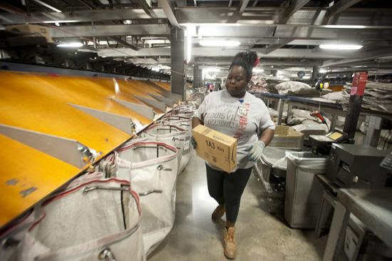 Cassandra Waters sorted packages at UPS's Worldport hub in Louisville. One of UPS's minority suppliers, Nexgen Mold & Tool, of New Albany, developed a custom mold for a package sorting wheel for UPS, saving the company 93 percent on the cost of wheels it was importing from Austria.