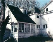 The more than 100-year-old Eitel House before it was restored after the firm purchased it in 1997. The home now is on the National Register of Historic Places.