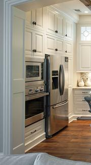 Appliances are from Bonnycastle Appliances and include: a microwave oven, wall oven, bottom drawer freezer, French door refrigerator, double-drawer dishwasher, and commercial-grade gas cooktop with eight burners.