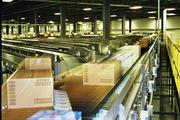 Boxes move along a conveyor belt in the distribution center.