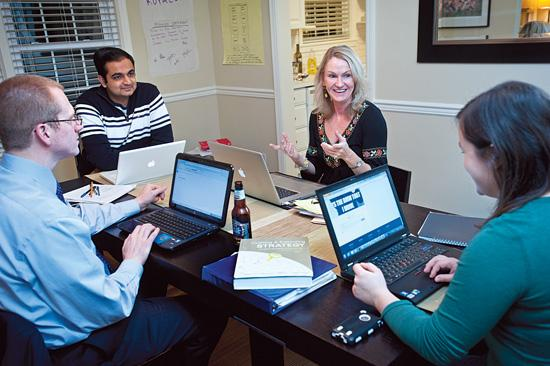 Justin Breitenstein, far left, Shalin Shah, left, Mary Thorsby, right, and Melissa Bagley, far right, worked on a project for their MBA class recently at Thorsby's home.