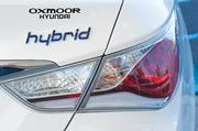 A logo is shown on the rear of the 2012 Hybrid Sonata, an environmentally friendly vehicle available locally.