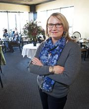 Kelly Ledford, manager of Uptown Cafe, is shown in one of the restaurant's dining rooms. Ledford says business during the holidays has improved steadily the last several years.