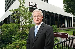 Hoyt Almond, regional president of BB&T Bank, is shown in front of the main branch on Main Street.