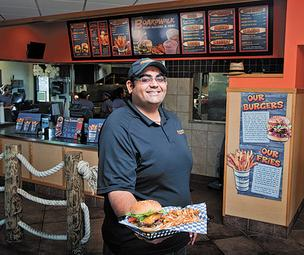 Umang Patel is shown in his Boardwalk Fresh Burgers & Fries restaurant, which is located at 2909 E. 10th St. in Jeffersonville