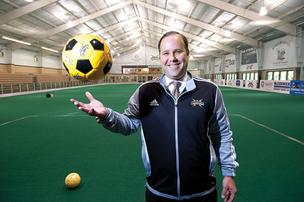 Attorney Scott Budnik, head coach of the Louisville Lightning soccer team, spends a lot of his free time at the Mockingbird Valley Soccer Club.